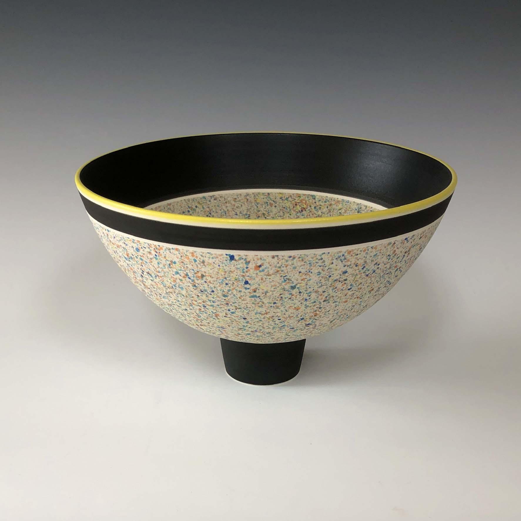 Pot 1. Black:Yellow flecked bowl on foot