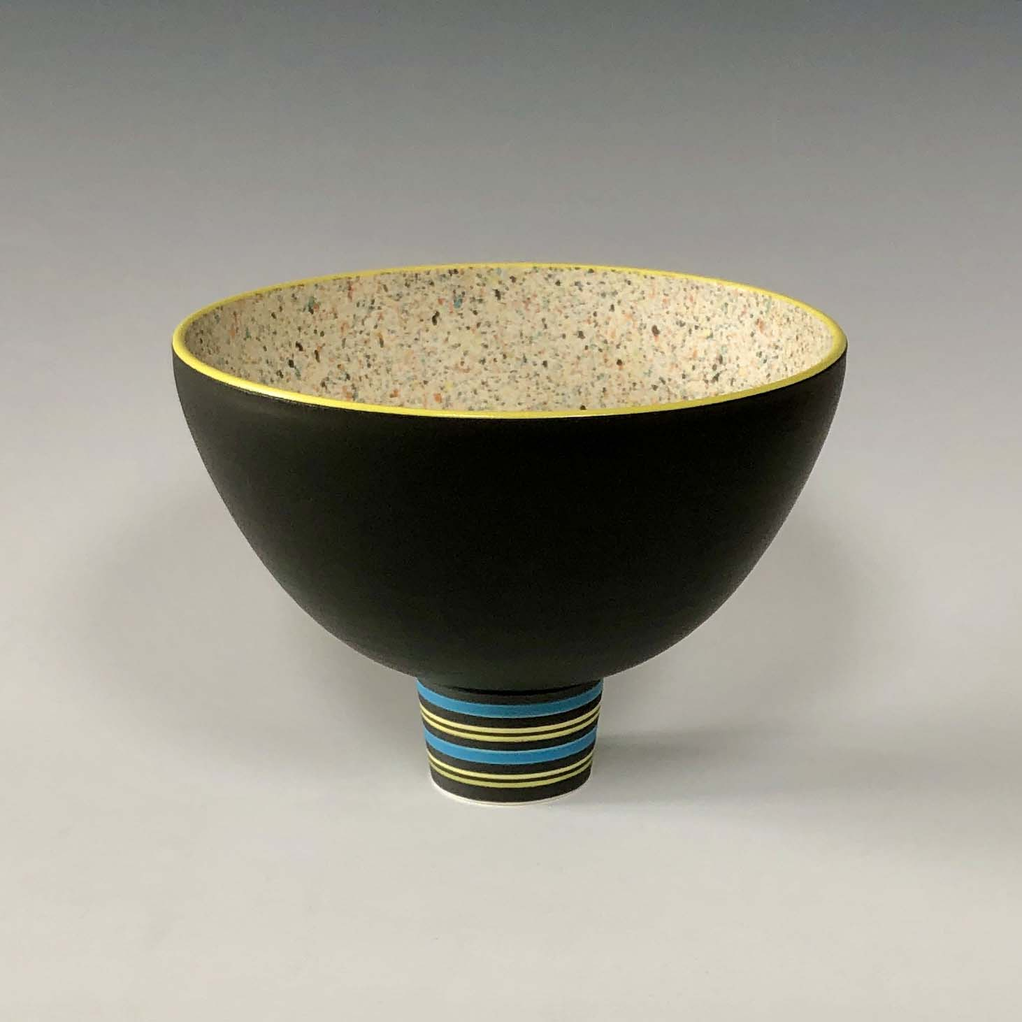 Pot 10. Black:Yellow flecked bowl on striped foot